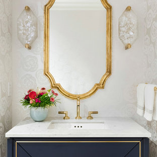 Inspiration for a timeless powder room remodel in Minneapolis with blue cabinets, beige walls, an undermount sink and gray countertops
