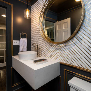 Inspiration for a small timeless white tile and marble tile medium tone wood floor, brown floor and wall paneling powder room remodel in Indianapolis with white cabinets, a one-piece toilet, blue walls, a vessel sink, quartz countertops, white countertops and a floating vanity