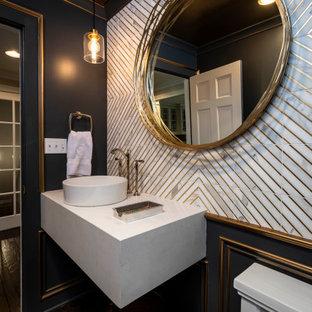 Exemple d'un petit WC et toilettes chic avec des portes de placard blanches, un WC à poser, un carrelage blanc, du carrelage en marbre, un mur bleu, un sol en bois brun, une vasque, un plan de toilette en quartz modifié, un sol marron, un plan de toilette blanc, meuble-lavabo suspendu et du lambris.