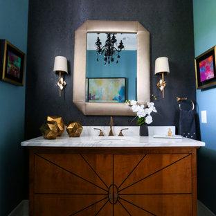 На фото: со средним бюджетом туалеты среднего размера в стиле современная классика с фасадами цвета дерева среднего тона, унитазом-моноблоком, серой плиткой, белой плиткой, каменной плиткой, синими стенами, паркетным полом среднего тона, накладной раковиной, столешницей из искусственного камня и плоскими фасадами