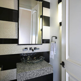 Design ideas for a small classic cloakroom in New Orleans with a vessel sink, flat-panel cabinets, black cabinets, engineered stone worktops, multi-coloured tiles, multi-coloured walls, porcelain flooring and multi-coloured worktops.