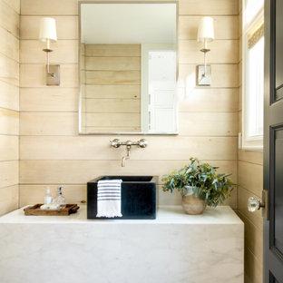 На фото: огромный туалет в морском стиле с бежевыми стенами, паркетным полом среднего тона, настольной раковиной, коричневым полом, белой столешницей, подвесной тумбой и деревянными стенами с