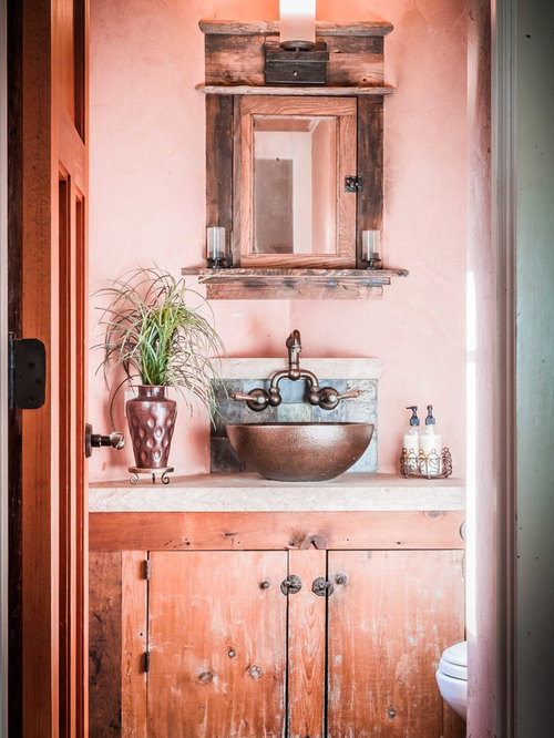 small rustic powder room idea in new york with a vessel sink flatpanel