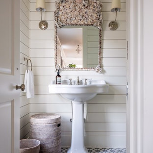 Inspiration for a medium sized nautical cloakroom in New York with multi-coloured tiles, blue tiles, white tiles, white walls, a pedestal sink and cement flooring.