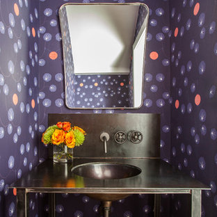 Example of a trendy powder room design in Houston with a console sink and multicolored walls