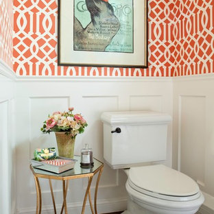 Example of a transitional medium tone wood floor powder room design in Denver with a pedestal sink and a two-piece toilet