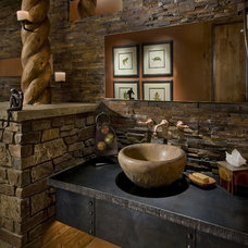 Rustic Powder Room by Identity Construction