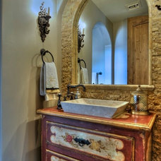 Mediterranean Powder Room by Integrity Luxury Homes