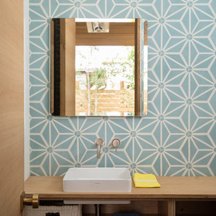 Design ideas for a midcentury cloakroom in Denver with open cabinets, light wood cabinets, blue tiles, multi-coloured tiles, white tiles, a vessel sink and wooden worktops.
