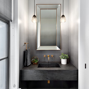 Small traditional cloakroom in Vancouver with grey walls, an integrated sink, concrete worktops, brown floors, dark hardwood flooring and grey worktops.