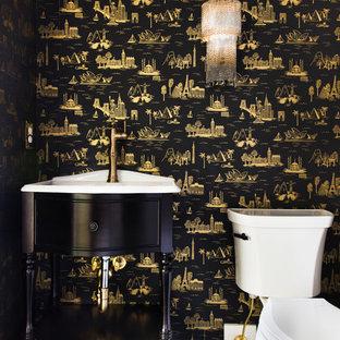 На фото: маленький туалет в стиле модернизм с фасадами островного типа, черными фасадами, раздельным унитазом, черными стенами и черным полом с