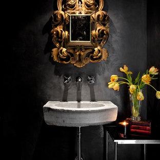 オースティンの地中海スタイルのおしゃれなトイレ・洗面所 (壁付け型シンク、黒い壁) の写真