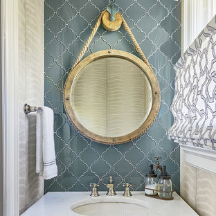Powder room - eclectic blue tile and glass tile powder room idea in Charlotte with an undermount sink, quartzite countertops and white countertops