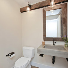 Farmhouse Powder Room by Hughes Construction, Inc