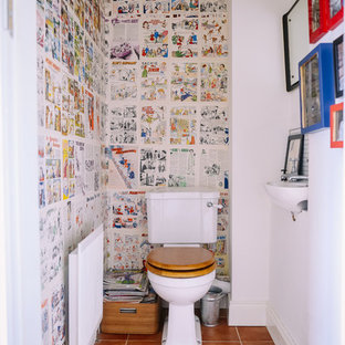 This is an example of a traditional cloakroom in Other with multi-coloured tiles, multi-coloured walls and terracotta flooring.