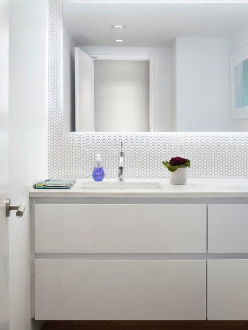 trendy white tile and ceramic tile dark wood floor and brown floor powder room photo in