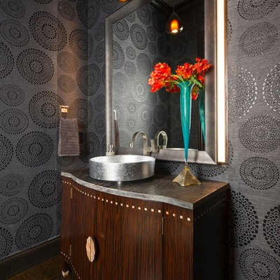 Example of a mid-sized transitional dark wood floor and brown floor powder room design in Other with furniture-like cabinets, dark wood cabinets, gray walls, a vessel sink, marble countertops and gray countertops