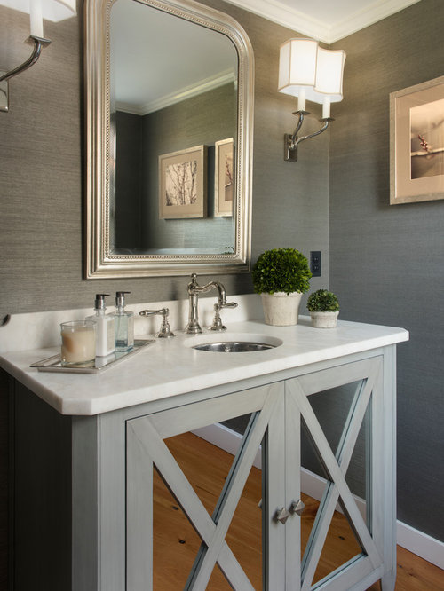 Inspiration For A Timeless Powder Room Remodel In Boston With Limestone Countertops