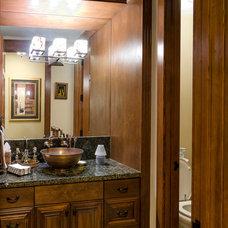 Traditional Powder Room by Artisan Inc.