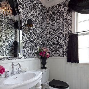 Mid-sized elegant dark wood floor and brown floor powder room photo in Minneapolis with a console sink and a two-piece toilet