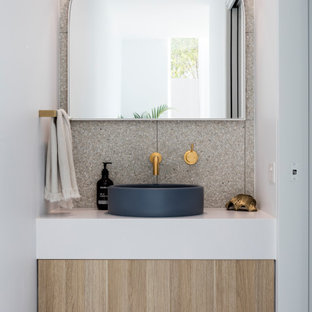 Design ideas for a beach style powder room in Sunshine Coast with flat-panel cabinets, light wood cabinets, a vessel sink, white benchtops and a floating vanity.