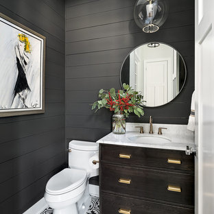 Photo of a farmhouse cloakroom in Chicago with freestanding cabinets, dark wood cabinets, a one-piece toilet, grey walls, a submerged sink and multi-coloured floors.