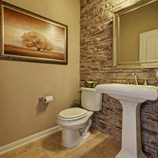 This is an example of a medium sized classic cloakroom in Austin with a pedestal sink, beige tiles, porcelain tiles, beige walls, limestone flooring and a two-piece toilet.