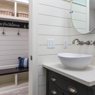 Mittelgroße Moderne Gästetoilette mit flächenbündigen Schrankfronten, grauen Schränken, Wandtoilette mit Spülkasten, weißer Wandfarbe, Laminat, Aufsatzwaschbecken, Quarzwerkstein-Waschtisch und beigem Boden in Grand Rapids