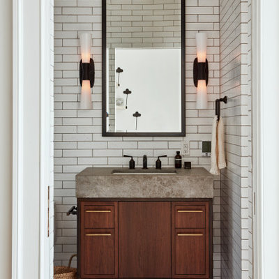Transitional white tile gray floor powder room photo in Philadelphia with flat-panel cabinets, dark wood cabinets, an undermount sink and gray countertops