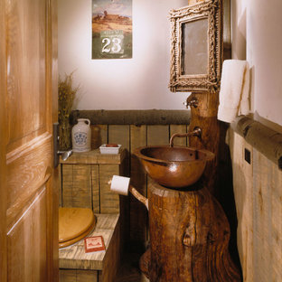 Mountain style powder room photo in Denver with a vessel sink