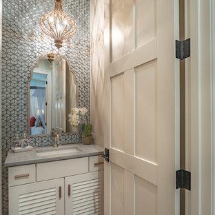 На фото: маленькие туалеты в стиле современная классика с фасадами с филенкой типа жалюзи, белыми фасадами, синей плиткой, стеклянной плиткой, бежевыми стенами, паркетным полом среднего тона, врезной раковиной, столешницей из искусственного кварца, коричневым полом и серой столешницей