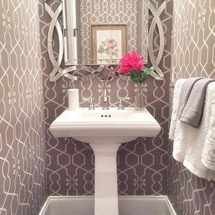 На фото: туалет среднего размера в стиле современная классика с коричневыми стенами, темным паркетным полом, раковиной с пьедесталом и коричневым полом с