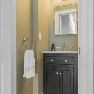 Foto di un bagno di servizio minimal di medie dimensioni con lavabo da incasso, ante di vetro, ante marroni, piastrelle bianche, piastrelle a mosaico e pavimento in gres porcellanato