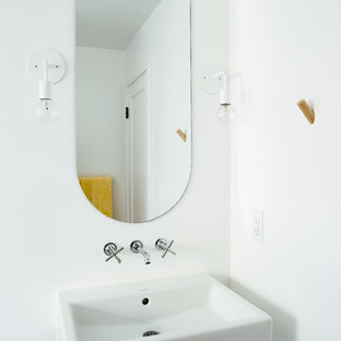 Design ideas for a small scandi cloakroom in Salt Lake City with white walls, porcelain flooring, a wall-mounted sink and green floors.