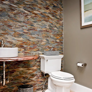 Photo of a medium sized traditional cloakroom in Other with open cabinets, multi-coloured tiles, slate tiles, light hardwood flooring, a built-in sink, wooden worktops and beige floors.