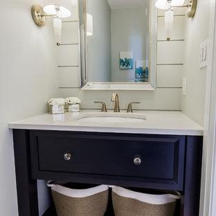 Стильный дизайн: туалет в стиле модернизм с открытыми фасадами, синими фасадами, унитазом-моноблоком, синей плиткой, полом из керамогранита, врезной раковиной, столешницей из искусственного кварца, белым полом и белой столешницей - последний тренд