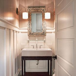 Cette image montre un WC et toilettes traditionnel de taille moyenne avec un sol en brique, un placard en trompe-l'oeil, des portes de placard en bois sombre, un mur gris, une grande vasque et un sol gris.