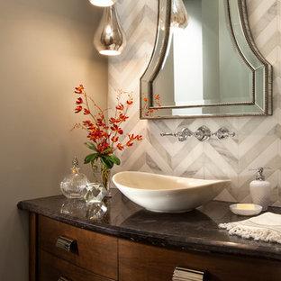 サンディエゴの中くらいのトランジショナルスタイルのおしゃれなトイレ・洗面所 (ベッセル式洗面器、家具調キャビネット、濃色木目調キャビネット、御影石の洗面台、グレーのタイル、グレーの壁、濃色無垢フローリング) の写真