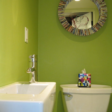 Tiny, bright green powder room with Duravit wall mount sink
