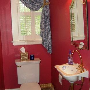 Неиссякаемый источник вдохновения для домашнего уюта: туалет среднего размера в стиле фьюжн с раздельным унитазом, красными стенами, полом из керамогранита, подвесной раковиной и черным полом