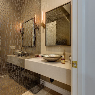 Design ideas for a contemporary cloakroom in Las Vegas with mosaic tiles, beige walls, a vessel sink, beige floors and beige worktops.
