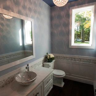 Inspiration for a medium sized traditional cloakroom in Other with a vessel sink, flat-panel cabinets, white cabinets, quartz worktops, a two-piece toilet, multi-coloured tiles, mosaic tiles and blue walls.