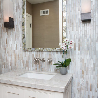 Design ideas for a small classic cloakroom in Los Angeles with shaker cabinets, beige cabinets, a one-piece toilet, multi-coloured tiles, glass tiles, beige walls, a built-in sink and quartz worktops.