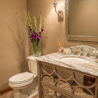 На фото: маленький туалет в классическом стиле с стеклянными фасадами, раздельным унитазом, бежевой плиткой, керамогранитной плиткой, бежевыми стенами, полом из керамогранита, врезной раковиной, столешницей из кварцита и бежевыми фасадами с