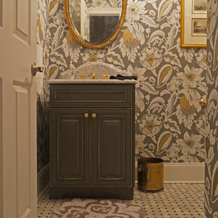 Example of a small classic black and white tile and stone tile marble floor powder room design in Philadelphia with raised-panel cabinets, distressed cabinets, a two-piece toilet, multicolored walls, an undermount sink and marble countertops