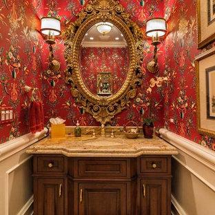Ispirazione per un bagno di servizio chic di medie dimensioni con ante con bugna sagomata, ante in legno bruno, pareti rosse, lavabo sottopiano e top in granito