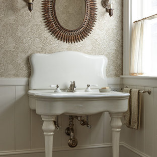 Example of a classic brown floor powder room design in New York