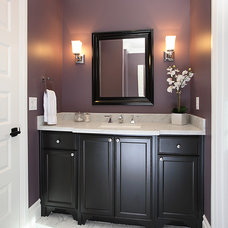 Traditional Powder Room by Precision Cabinets