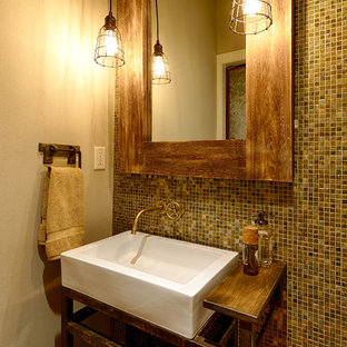 This is an example of a medium sized classic cloakroom in Seattle with a vessel sink, wooden worktops, multi-coloured tiles, glass tiles, white walls and brown worktops.