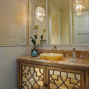 Свежая идея для дизайна: туалет в средиземноморском стиле с настольной раковиной, паркетным полом среднего тона и фасадами островного типа - отличное фото интерьера